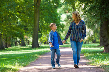 single mom and son walking together