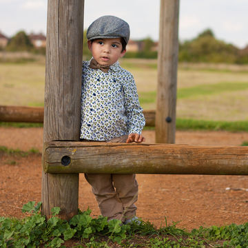 toddler-wearing-borselino-cap-and-bow-tie-in-a-field_600x600_getty-169485141