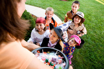 group of trick-or-treaters at door
