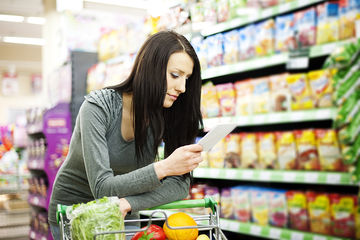 woman looking at shopping list