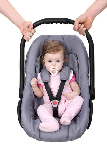 Baby Girl Wearing Pink In Carseat