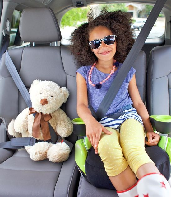 Little Girl Sitting In Car Seat with Teddy Bear