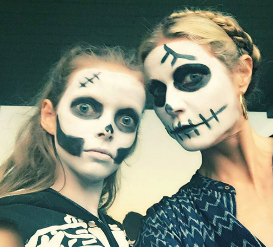 Gwyneth Paltrow and Apple in skeleton facepaint