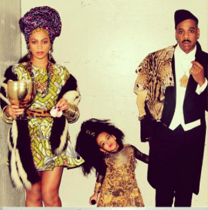 Beyonce Jay Z and Blue Ivy in Coming to America Halloween costumes