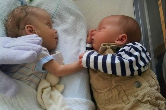 cooper and lucas holding hands