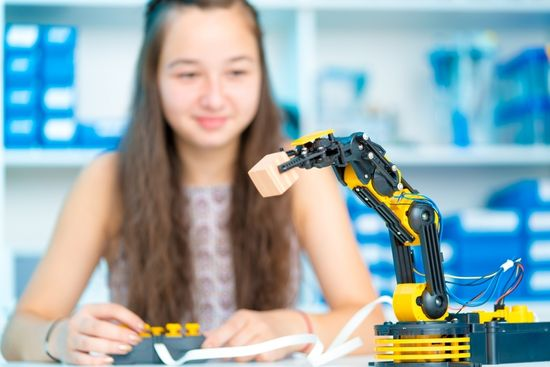 girl using robot in science lab