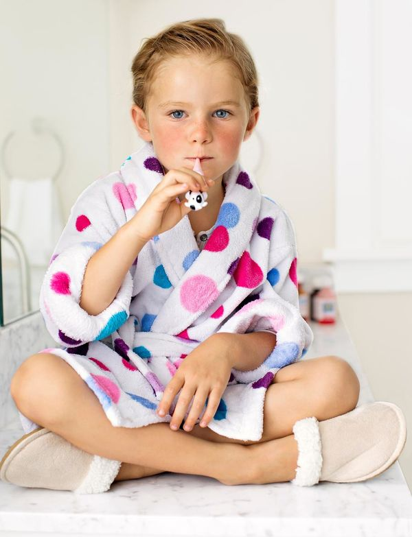 Child Sitting In Robe With Thermometer