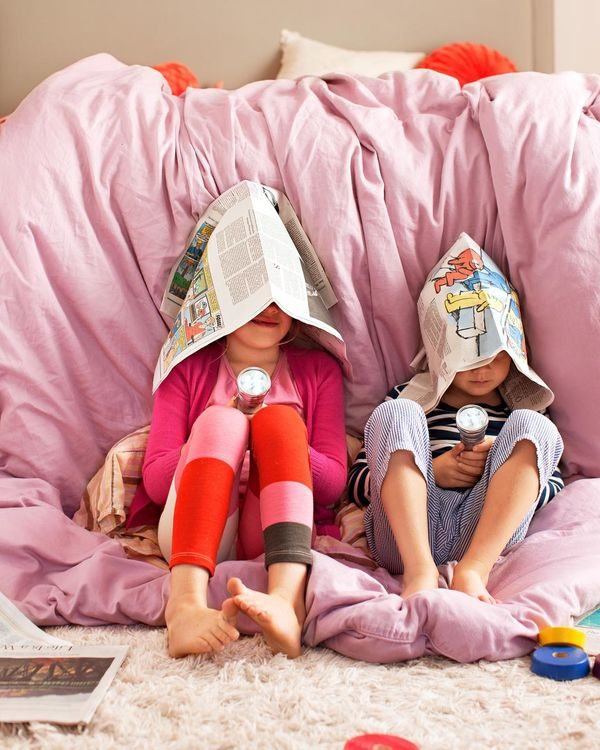 Two Girls Play Silly Game Newspaper on Head