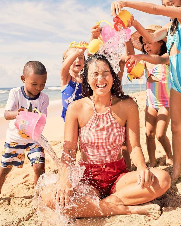 Family Summer Memories Kids Pour Water on Womans Head at the Beach