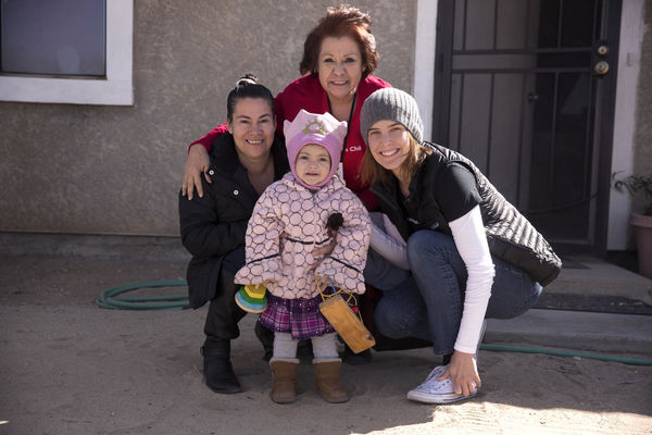 Cobie Smulders with Save the Children Early Childhood Coordinator Maria and a Family