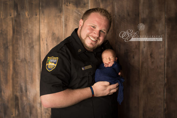 Baby police father