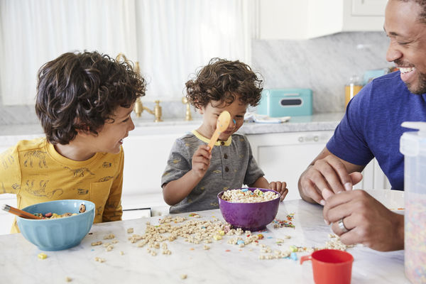 Father and Sons Making Cereal Messy