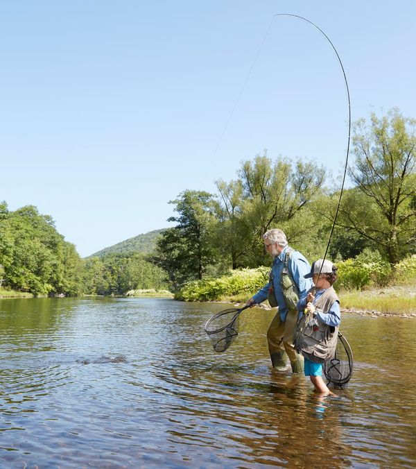 Man and Boy Fly Fishing