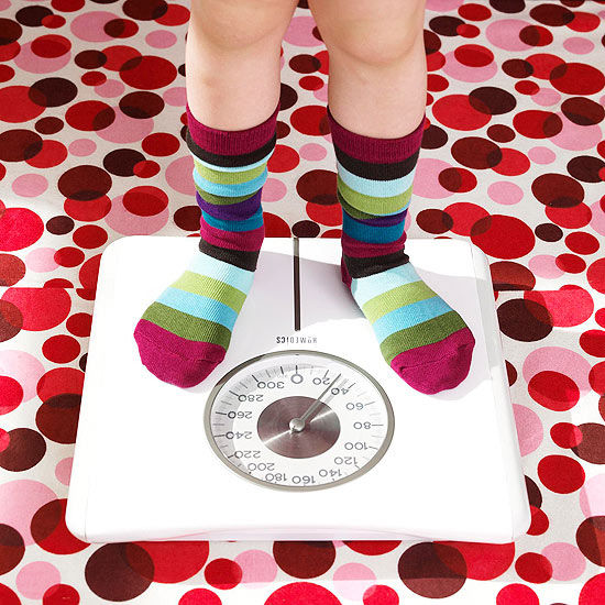 Child standing on a scale