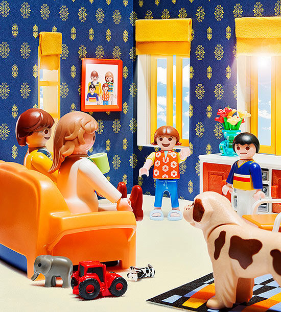 Playmobil figures in a living room set