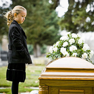 child attending a funeral