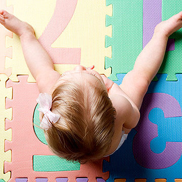 toddler sitting on the floor