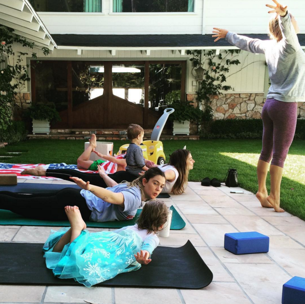 Drew Barrymore does yoga with Olive