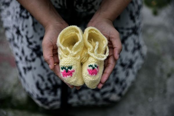 miscarriage concept with baby shoes