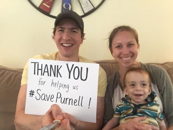 Sabky family with Save Purnell sign