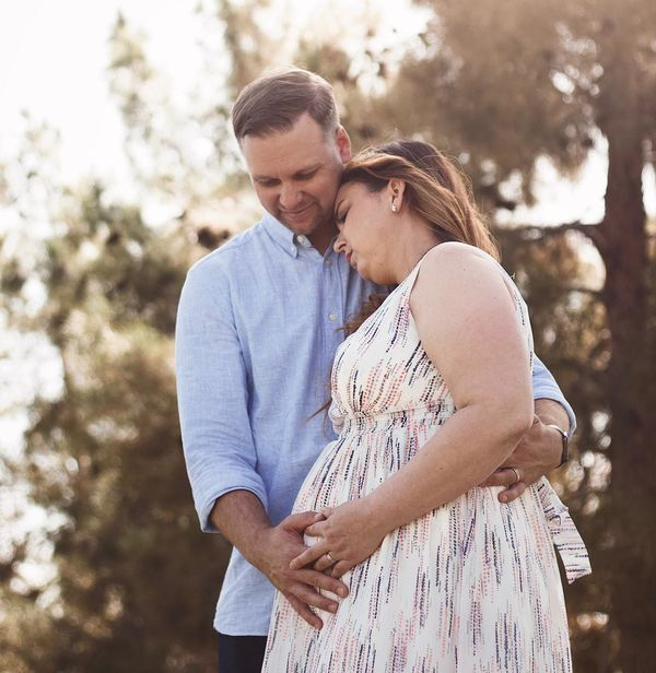 Pregnant Couple Outside Wife Leaning On Husband