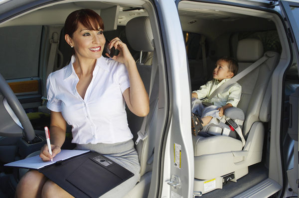 Woman on Phone with Child in Car Seat