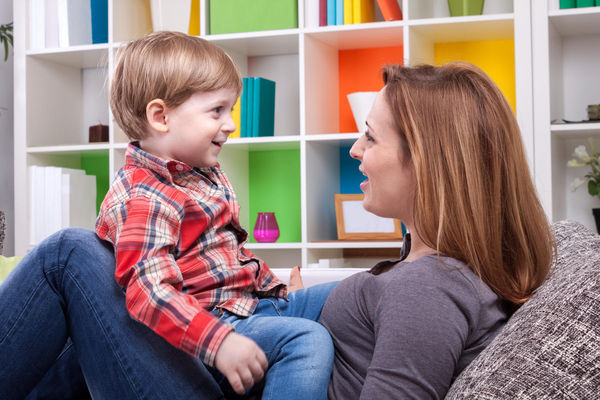 mom and toddler son talking