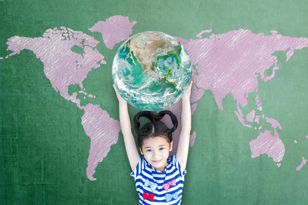 Girl Holding Globe in Hands