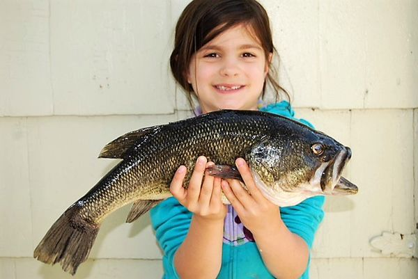 Liz Vaccariello Daughter Olivia Holding a Fish