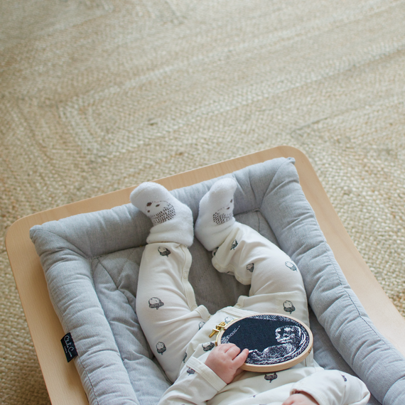 Baby Holding Embroidery Hoop with Embroidered Sonogram Photo